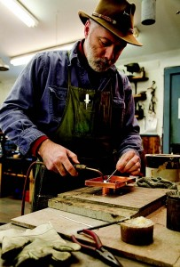 Michael Krauss, owner of Authentic Designs, makes a lantern in his Vermont workshop.