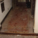 "The distinctive entry tile was a distinguishing feature of the Tudor house. The team protected it with ½"" plywood during construction, then repaired cracked tiles using color-matched grout."