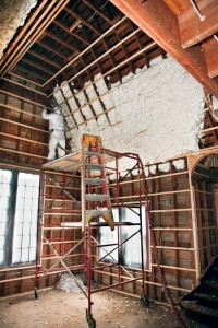 Two varieties of high-tech insulation were installed in the house—white open-cell foam in attic rafters and dense-pack gray cellulose on the walls.