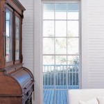 Floor-level double-hung windows that open onto the porch are a traditional feature of nineteenth-century Southern homes.