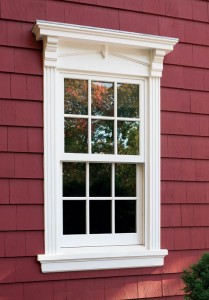 The detailing on this Norwood window designed by architect Peter Zimmerman reflects classical elements, with its pediment and reed trim.