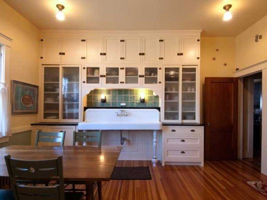 Salvaged cabinets and a 6' sink are the centerpiece of this lovingly restored 1920s bungalow kitchen.