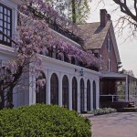 Wisteria is trained along a sturdy trellis at the 1730 Peirce–du Pont House at Longwood Gardens in Pennsylvania.