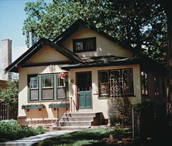 Johnson's bungalow had a typical floor plan: two downstairs bedrooms divided by a bath, a colonnade dividing living and dining rooms, and a swinging door into the kitchen.