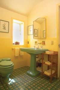Yellow and green were a fairly common combination, but the floor is a showstopper. The unusual pattern was created by the homeowner, who implemented many fashion trends during her home's construction in 1932.
