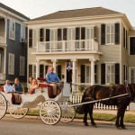Neighborhood survivors of Hurricane Ike accompany Leonard and Kevin on a carriage ride past the restored house.