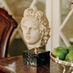 A reproduction head from the Vatican sits atop a Victorian table found in a Galveston antique shop.
