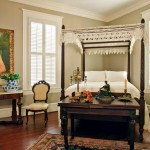 In the master bedroom, a late-1800s mahogany canopy bed with turned finials is adorned with antique handmade lacework.