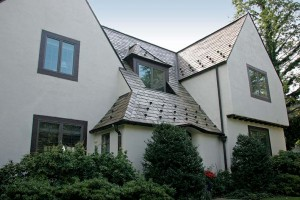 """The """"before"""" view of the house shows a mixup of modern replacement windows with no divided lights."""