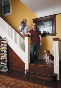 Christina with husband Rick, baby Jack, and the family beagle on the stairs of their 1890s house in New Jersey.