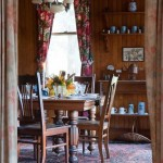 The early 20th-century oak dining table and chairs came with the house. Walls glow with the original beadboard paneling.