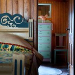 """Painted """"cottage furniture""""—beds and dressers, even side chairs—remains in bedrooms upstairs."""