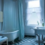 Original fixtures in an upstairs bath include a 19th-century clawfoot tub and porcelain sink.