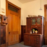 A very early Hoosier cabinet (dating to the 1890s) provides a remarkable amount of storage space without making the kitchen look modern.