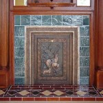 Tile panels suggest cattails at sunset in this fireplace surround by L'Esperance.