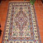"""Even the rug's """"fringe"""" is part of a tile mural by Native Tile."""