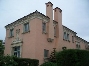 Its pink exterior and double chimneys make the Warden House hard to miss.