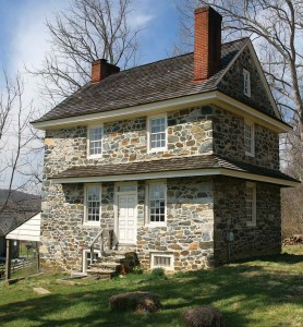 The 1725 John Chad House has traditional pent eaves between the stories.