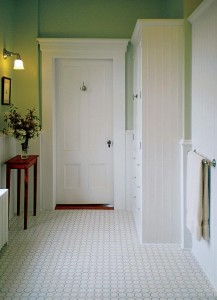 Patrick and Joyce repainted the original beadboard wainscoting a crisp white, complemented by soothing green walls.