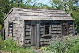 The garden shed at the Oldest House on Nantucket was constructed well after the 1686 home, but hews to its aesthetic by using weathered materials.