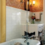 A guest bath mixes an original tub and shower with a more contemporary vanity and sink.