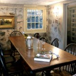 The room's walls were faux painted by artist Dawn D'Alusio to evoke rough stone.