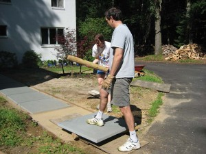 The author and her husband work to lay 3' x 3' pavers.