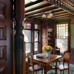 In a dining nook, Queen Anne window sash is the backdrop for woodwork and a full-width spandrel in the Eastlake manner.