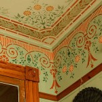 On a stenciled frieze and ceiling in the guest bedroom, color selection is as important as the design.