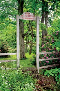 The well-known wooden Stile Gate into Arden opens to a picturesque walkway leading to the Green.