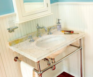 After the marble sink tops were refinished, they were fitted with new basins, period-style legs, and reproduction fixtures.