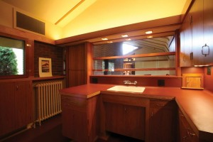 Frank Lloyd Wright designed the Willey kitchen with a wall of plate glass windows and a door adjoining the living room, features that put the space on display in a way that was unusual for its time.