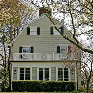 "After the book and movie came out, new owners of the ""Amityville Horror"" house replaced the arched windows in the gable of the Dutch Colonial to make it less recognizable."