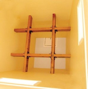 Atop the finished tower's interior, 4x8 collars placed horizontally (and plated and through-bolted) add extra support.