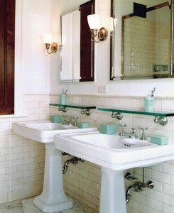 Subway tiles topped with round cap molding forge a crisp-looking bath.