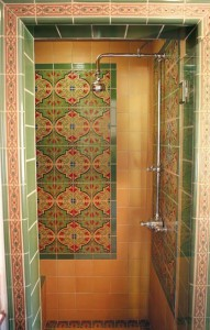 Inset tile panels featuring floral designs in complementary colors became popular in the 1930s, and can be a good solution when matching tile is impossible.