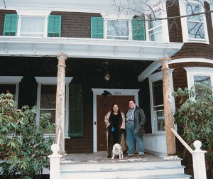 """Celine, Tony, and Gypsy surveying the work-in-progress front porch, which did extra duty as a """"pre-disposal storage area"""" for several rooms' worth of discarded carpeting."""