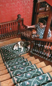 One of Gypsy's favorite perches is in the middle landing of the large front-hall staircase, where she can poke her snout between balusters to supervise contractors.