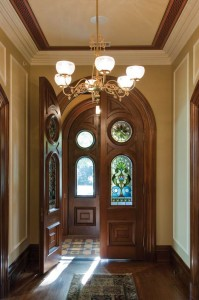 The stained glass is an original survivor; the front doors were rehabbed by  restoration contractor Gary Griswold.
