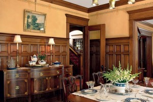 After stripping paint off of the woodwork in the dining room, it became apparent that the oak paneling on one wall had been replaced with birch. Installing new oak paneling would have added thousands of dollars to the project's bottom line, so Bob Chickey of RCP Fine Finish suggested painting a faux wood grain on the birch paneling to make it match the oak.