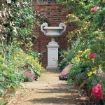 Neoclassical ornaments like Haddonstone's 'Hadrian Vase' were popular focal points in Revival gardens.