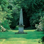 A stone or concrete obelisk draws the eye; this one is from Haddonstone.