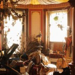 "The tower room, part of the front parlor, is outfitted as an oriental ""Turkish corner"" with a fabric-draped ceiling, Moorish-inspired wallpapers, Turkey rugs, Bedouin textiles, and Egyptian Revival pieces."