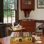 The Hoods' main showroom mimics a mid-18th-century mid-Atlantic tavern, with checkers and card games on the reproduction game table. Windsor chairs are convivial.