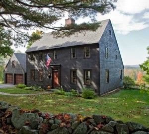 New England iconography in a 17th-century-style Saltbox house, dry-laid stone walls, and the sweetly evocative landscape ablaze with autumn foliage.