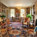 The old living room and an adjacent small room became a large library, furnished with antiques. A door leads from this room to the breezeway and the home office in the barn.