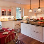 The new kitchen is traditional, with soapstone countertops, a Delft-tile backsplash behind the French cookstove, and white-painted cabinets built by Maine's Kennebec Company.