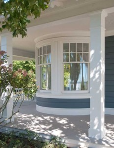 Eight-over-one curved sash fits the rounded bay on an old house.