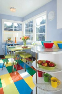 The owner of this mid-century cottage painted (and then varnished) her worn gray linoleum in a patchwork of bright colors. Photo: William Wright