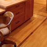 Strip oak wood flooring with a decorative inlay.